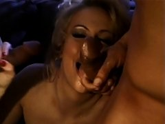 Sexy blonde takes two hard cocks in her mouth at once after fucking