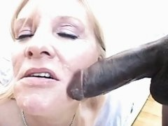 Blonde milf sucks large black cock